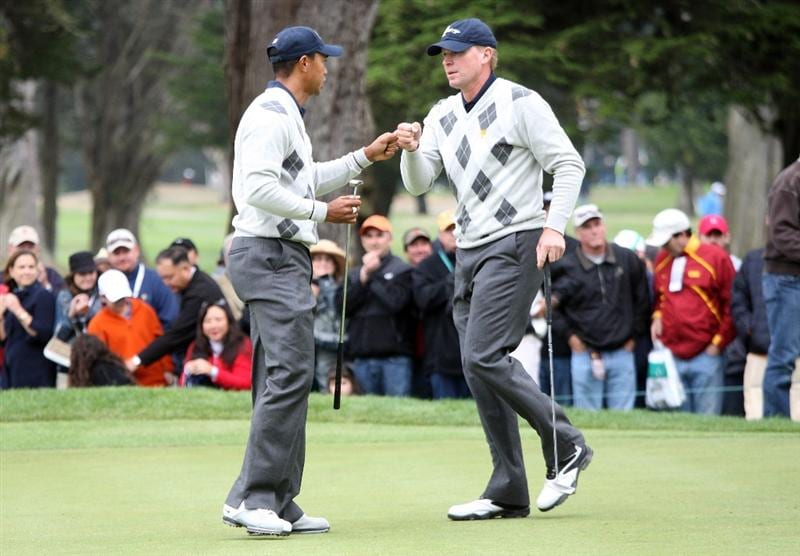 SAN FRANCISCO - OCTOBER 10:  Tiger Woods of the USA congratulates his partner Steve Stricker after Stricker had holed a long putt for birdie at the 7th hole during the Day Three Afternoon Fourball Matches in The Presidents Cup at Harding Park Golf Course on October 10, 2009 in San Francisco, California  (Photo by David Cannon/Getty Images)