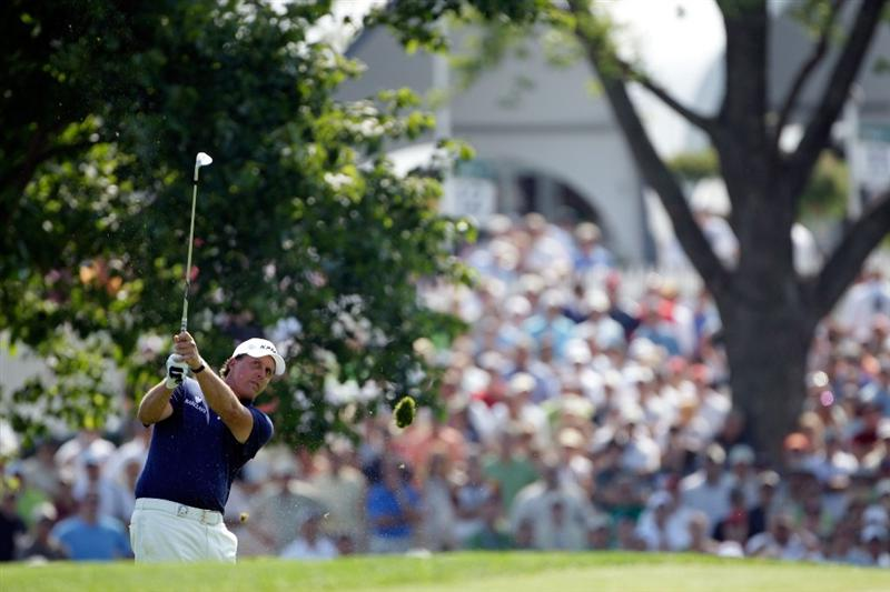 CHASKA, MN - AUGUST 14:  Phil Mickelson plays a shot on the 18th hole during the second round of the 91st PGA Championship at Hazeltine National Golf Club on August 14, 2009 in Chaska, Minnesota.  (Photo by Jamie Squire/Getty Images)
