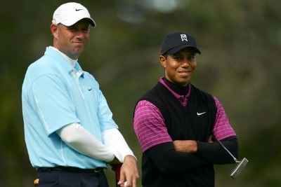 Tiger Woods smiles with Stewart Cink on the ninth hole during the third round of the Buick Invitatoinal at the Torrey Pines Golf Course on January 26, 2008 in La Jolla, California. PGA TOUR - 2008 Buick Invitational - Round ThreePhoto by Harry How/Getty Images