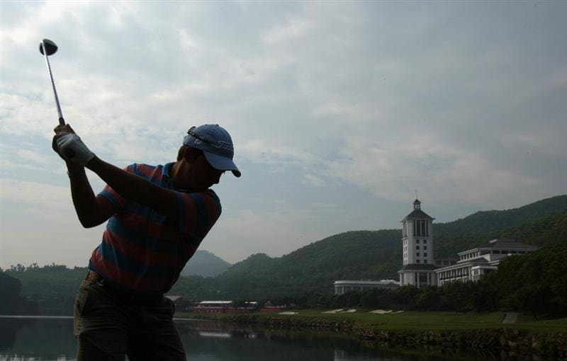 SHENZHEN, CHINA - NOVEMBER 26:  Pablo Larrazabal of Spain plays his tee shot during the pro - am of the Omega Mission Hills World Cup at the Mission Hills Resort on November 26, 2008 in Shenzhen, China.  (Photo by Stuart Franklin/Getty Images)