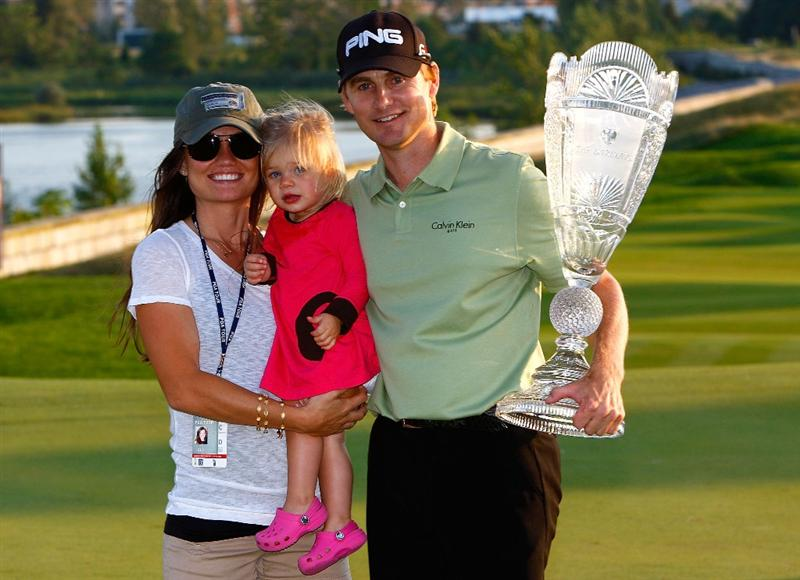 JERSEY CITY, NJ - AUGUST 30:  Heath Slocum poses with the championship trophy along with his wife Victoria and daughter Stella after winning The Barclays on August 30, 2009 at Liberty National in Jersey City, New Jersey.  (Photo by Kevin C. Cox/Getty Images)