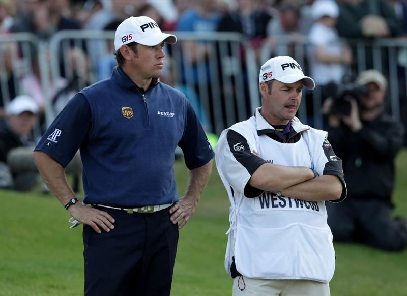 VIRGINIA WATER, ENGLAND - MAY 29:  Lee Westwood of England and Caddy Billy Foster look dejected after losing the playoff during the final round of the BMW PGA Championship  at the Wentworth Club on May 29, 2011 in Virginia Water, England.  (Photo by Ross Kinnaird/Getty Images)