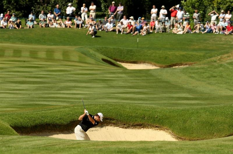 VIRGINIA WATER, ENGLAND - MAY 22:  Lee Westwood of England hits his second shot on the 3rd hole during the third round of the BMW PGA Championship on the West Course at Wentworth on May 22, 2010 in Virginia Water, England.  (Photo by Ian Walton/Getty Images)