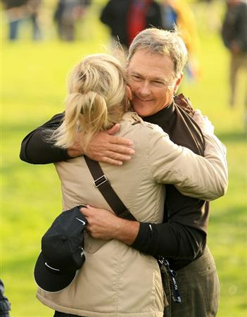 SAN FRANCISCO - NOVEMBER 07:  John Cook hugs his wife, Jan, after winning the Charles Schwab Cup Championship at Harding Park Golf Course on November 7, 2010 in San Francisco, California.  (Photo by Ezra Shaw/Getty Images)