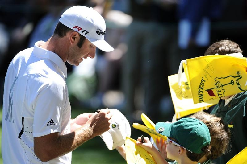 AUGUSTA, GA - APRIL 06:  Dustin Johnson signs autographs during the Par 3 Contest prior to the 2011 Masters Tournament at Augusta National Golf Club on April 6, 2011 in Augusta, Georgia.  (Photo by Harry How/Getty Images)