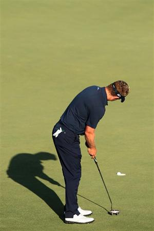 PONTE VEDRA BEACH, FL - MAY 15:  Luke Donald of England putts on the 18th hole during the final round of THE PLAYERS Championship held at THE PLAYERS Stadium course at TPC Sawgrass on May 15, 2011 in Ponte Vedra Beach, Florida.  (Photo by Scott Halleran/Getty Images)