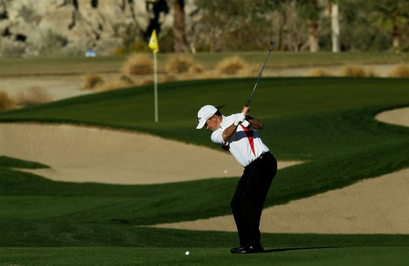 LA QUINTA, CA - JANUARY 22:   Greg Chalmers of Australia hits his second shot on the 11th hole during round four of the Bob Hope Classic at Silver Rock Resort on January 22, 2011 in La Quinta, California. (Photo by Stephen Dunn/Getty Images)