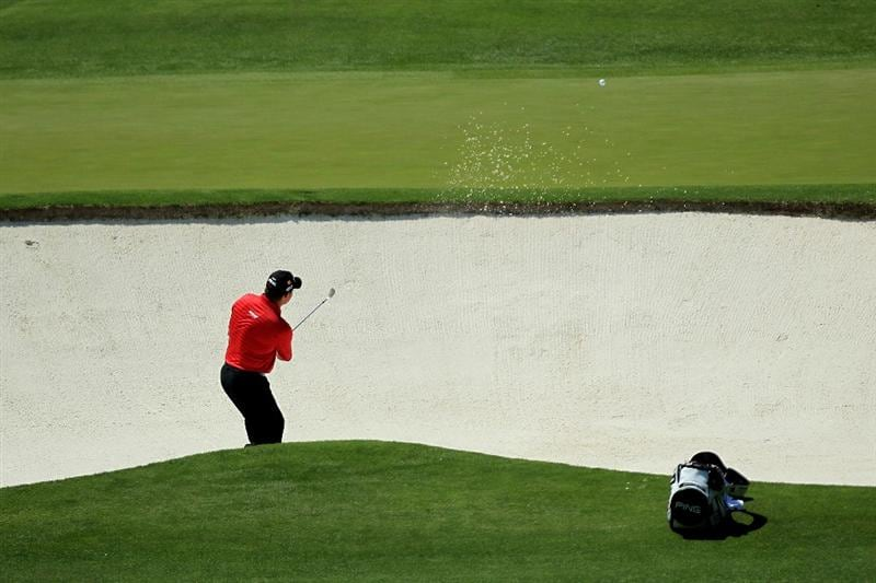 AUGUSTA, GA - APRIL 10:  Lee Westwood of England plays a bunker shot on the fourth hole during the final round of the 2011 Masters Tournament on April 10, 2011 in Augusta, Georgia.  (Photo by David Cannon/Getty Images)