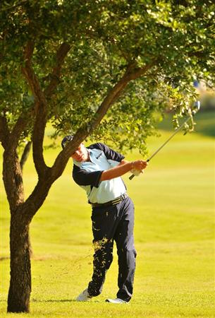 IRVING TX. - MAY 22:  Brian Davis hits out of the rough on the 16th hole during the second round of  the HP Byron Nelson Championship held at the TPC Four Seasons Resort Las Colinas on May 22, 2009 in Irving, Texas (Photo by Marc Feldman/Getty Images)