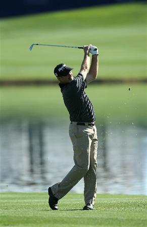 LA QUINTA, CA - JANUARY 21:  Jerry Kelly hits his second shot on the 10th hole during round three of the Bob Hope Classic at the Palmer Private Course at PGA West on January 21, 2011 in La Quinta, California.  (Photo by Stephen Dunn/Getty Images)
