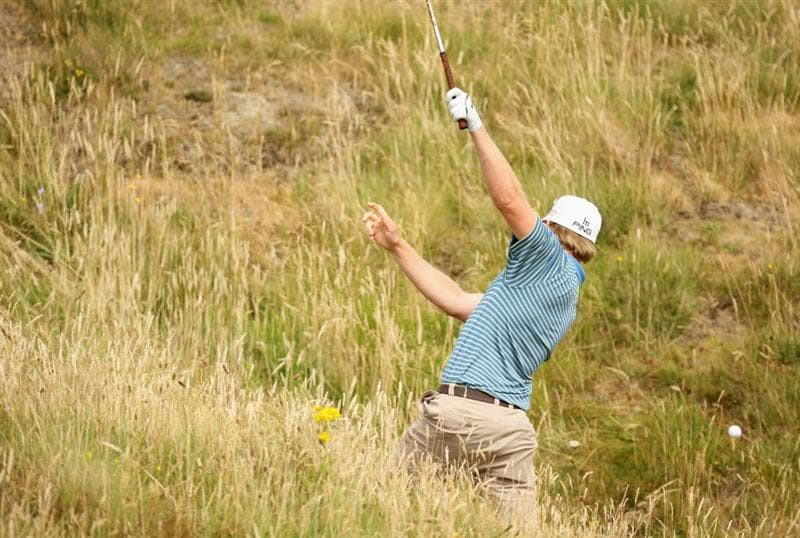 TURNBERRY, SCOTLAND - JULY 16:  Hunter Mahan of USA hits out of the rough during round one of the 138th Open Championship on the Ailsa Course, Turnberry Golf Club on July 16, 2009 in Turnberry, Scotland.  (Photo by Ross Kinnaird/Getty Images)