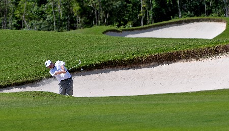 PLAYA DEL CARMEN, MEXICO - FEBRUARY 23:  Kevin Streelman hits out of the fairway bunkero on the on the first  hole during the third round of the Mayakoba Golf Classic at Riviera Maya February 23, 2008 in Playa del Carmen, Quintana Roo, Mexico.  (Photo by Marc Feldman/Getty Images)