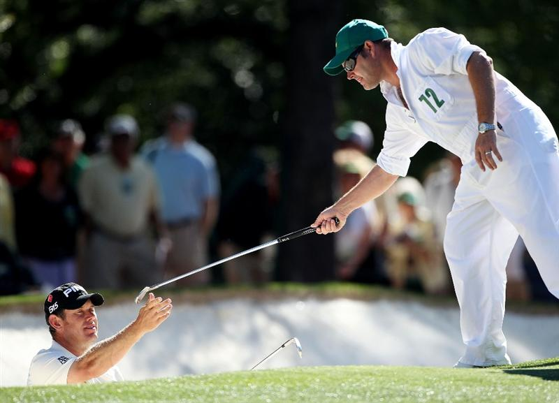 AUGUSTA, GA - APRIL 07:  Lee Westwood of England takes a club from his caddie Billy Foster on the first hole during the first round of the 2011 Masters Tournament at Augusta National Golf Club on April 7, 2011 in Augusta, Georgia.  (Photo by Andrew Redington/Getty Images)