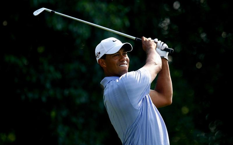 SHANGHAI, CHINA - NOVEMBER 06:  Tiger Woods of the USA watches his tee shot on the fourth hole during the second round of the WGC-HSBC Champions at Sheshan International Golf Club on November 6, 2009 in Shanghai, China.  (Photo by Scott Halleran/Getty Images)
