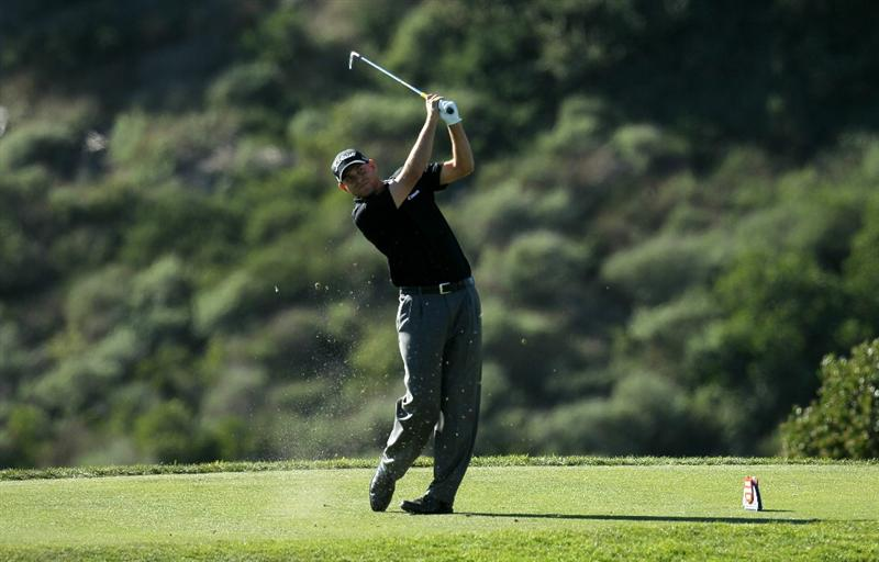 LA JOLLA, CA - JANUARY 28:  Bill Haas hits his tee shot on the eighth hole during round two of the Farmers Insurance Open at Torrey Pines South Course on January 28, 2011 in La Jolla, California.  (Photo by Stephen Dunn/Getty Images)