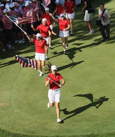 SUGAR GROVE, IL - AUGUST 23: Michelle Wie, Paula Creamer, Christina Kim and Morgan Pressel of the U.S. Team celebrate after their victory over the European Team during the Sunday singles matches at the 2009 Solheim Cup Matches, at the Rich Harvest Farms Golf Club on August 23, 2009 in Sugar Grove, Ilinois (Photo by David Cannon/Getty Images)