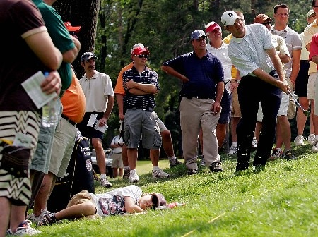ROCHESTER, NY - AUGUST 17:  (EDITORS NOTE: THIS IMAGE IS RETRANSMITTED WITH AN ALTERNATE CROP) Jonathan Fricke plays his second shot to the 12th hole as a child sleeps nearby during the fourth round of the Xerox Classic at the Irondequoit Country Club held on  August 17, 2008 in Rochester, New York.  (Photo by Michael Cohen/Getty Images)