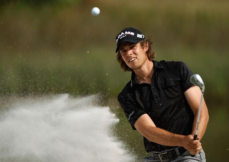 HILTON HEAD ISLAND, SC - APRIL 17:  Aaron Baddeley of Australia plays a bunker shot on the 17th hole during the third round of the Verizon Heritage at the Harbour Town Golf Links on April 17, 2010 in Hilton Head lsland, South Carolina.  (Photo by Scott Halleran/Getty Images)