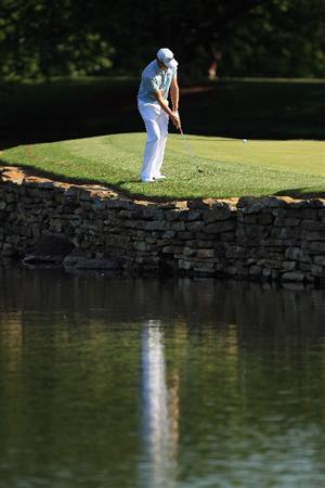 CHARLOTTE, NC - MAY 05:  Nick Watney chips the ball on the 17th hole during the first round of the Wells Fargo Championship at Quail Hollow Club on May 5, 2011 in Charlotte, North Carolina.  (Photo by Streeter Lecka/Getty Images)