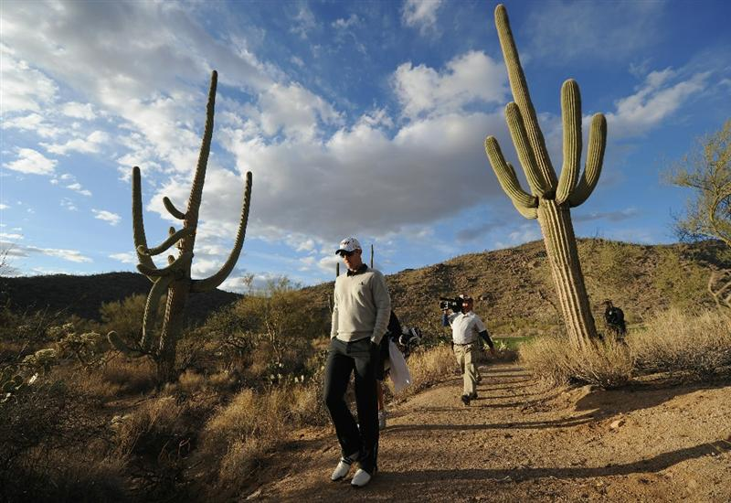 MARANA, AZ - FEBRUARY 23:  Justin Rose of England walks between the cactus during the first round of the World Golf Championships-Accenture Match Play Championship held at The Ritz-Carlton Golf Club, Dove Mountain on February 23, 2011 in Marana, Arizona.  (Photo by Stuart Franklin/Getty Images)