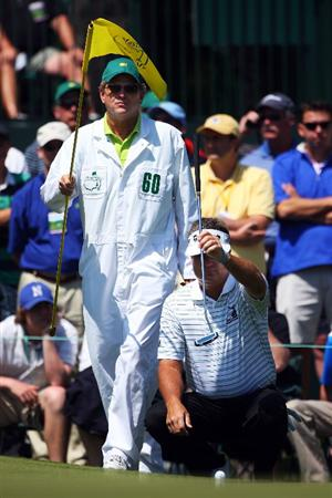 AUGUSTA, GA - APRIL 12:  Kenny Perry and his caddie Fred Sanders line up a putt on the first green during the final round of the 2009 Masters Tournament at Augusta National Golf Club on April 12, 2009 in Augusta, Georgia.  (Photo by Andrew Redington/Getty Images)