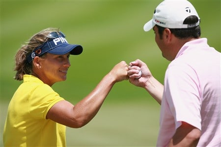 AVENTURA, FL - APRIL 25:  Angela Stanford celebrates with her teammate Matt Troka after a birdie on the 12th hole during the second round of the Stanford International Pro-Am at Fairmont Turnberry Isle Resort & Club on April 25, 2008 in Aventura, Florida.  (Photo by Doug Benc/Getty Images)