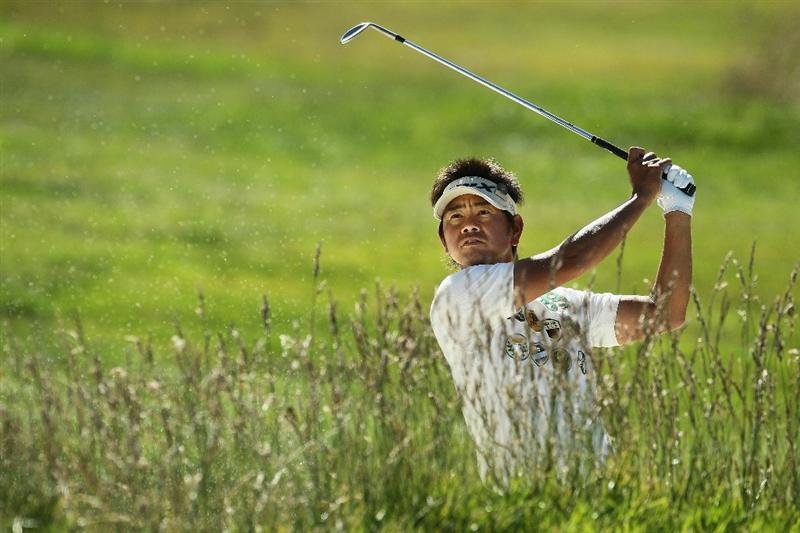 PEBBLE BEACH, CA - JUNE 16:  Hiroyuki Fujita of Japan plays a bunker shot during a practice round prior to the start of the 110th U.S. Open at Pebble Beach Golf Links on June 16, 2010 in Pebble Beach, California.  (Photo by Jeff Gross/Getty Images)