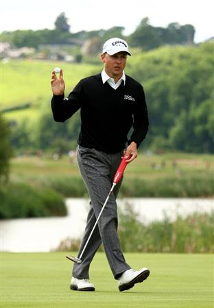 NEWPORT, WALES - JUNE 07:  Niclas Fasth of Sweden celebrates as he holes a crucial putt on the 14th green during the final round of the Celtic Manor Wales Open on the 2010 Course at The Celtic Manor Resort on June 7, 2009 in Newport, Wales.  (Photo by Richard Heathcote/Getty Images)