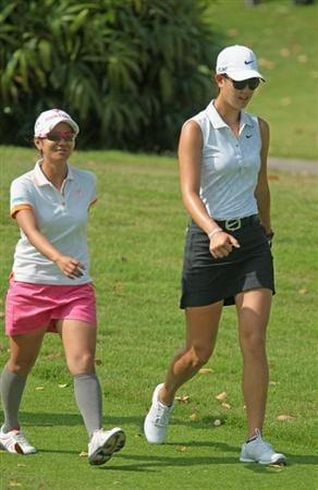 SINGAPORE - FEBRUARY 24:  Ai Miyazato of Japan (L) walks off the first tee alongside Michelle Wie of the USA during the first round of the HSBC Women's Champions 2011 at the Tanah Merah Country Club on February 24, 2011 in Singapore, Singapore.  (Photo by Scott Halleran/Getty Images)