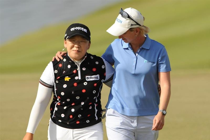 WEST PALM BECH, FL - NOVEMBER 23:  Ji-Yai Shin (L) of South Korea and Karrie Webb of Australia walk off the green after the final round of the ADT Championship at the Trump International Golf Club on November 23, 2008 in West Palm Beach, Florida.  (Photo by Montana Pritchard/Getty Images)