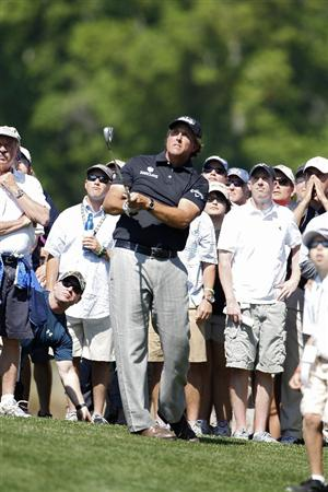 HUMBLE, TX - MARCH 31:  Phil Mickelson hits a shot from the rough during the first round of the Shell Houston Open at Redstone Golf Club on March 31, 2011 in Humble, Texas.  (Photo by Michael Cohen/Getty Images)
