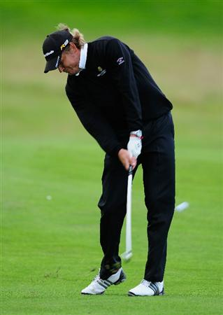 PARIS - SEPTEMBER 25:  Jarmo Sandelin of Sweden plays his approach shot on the 18th hole during the third round of the Vivendi cup at Golf de Joyenval on September 25, 2010 in Chambourcy, near Paris, France.  (Photo by Stuart Franklin/Getty Images)