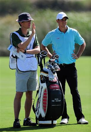 VILAMOURA, PORTUGAL - OCTOBER 15:  Mads Vibe-Hastrup of Denmark and caddie on the 18th hole during the first round of the Portugal Masters at the Oceanico Victoria Golf Course on October 15, 2009 in Vilamoura, Portugal.  (Photo by Stuart Franklin/Getty Images)