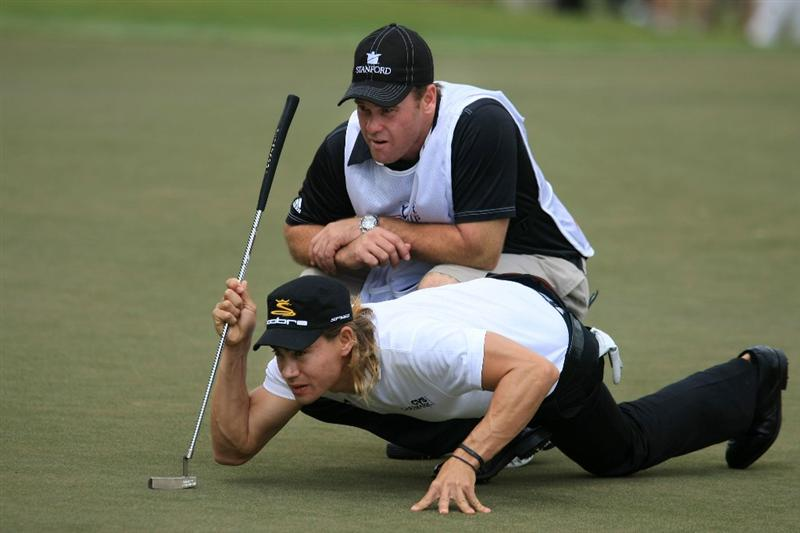ATLANTA - SEPTEMBER 27:  Camilo Villegas of Columbia lines up a putt on the sixth hole with the help of his caddie Gary Matthews during the third round of THE TOUR Championship presented by Coca-Cola, at East Lake Golf Club on September 27, 2008 in Atlanta, Georgia. This is the final event of the PGA TOUR Playoffs for the FedExCup.  (Photo by Scott Halleran/Getty Images)