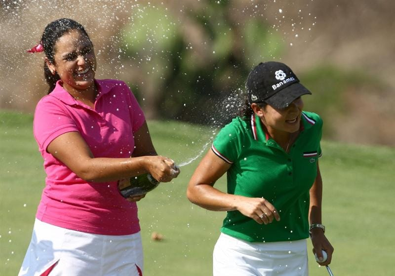 MORELIA, MEXICO- APRIL 26:  Lorena Ochoa of Mexico is sprayed by chapagne by top amatuer player in the tournament Daniela Ortiz after Ochoa's 25-under par victory during the final round of the Corona Championship at the Tres Marias Residential Golf Club on April 26, 2009 in Morelia, Michoacan, Mexico. (Photo by Donald Miralle/Getty Images)