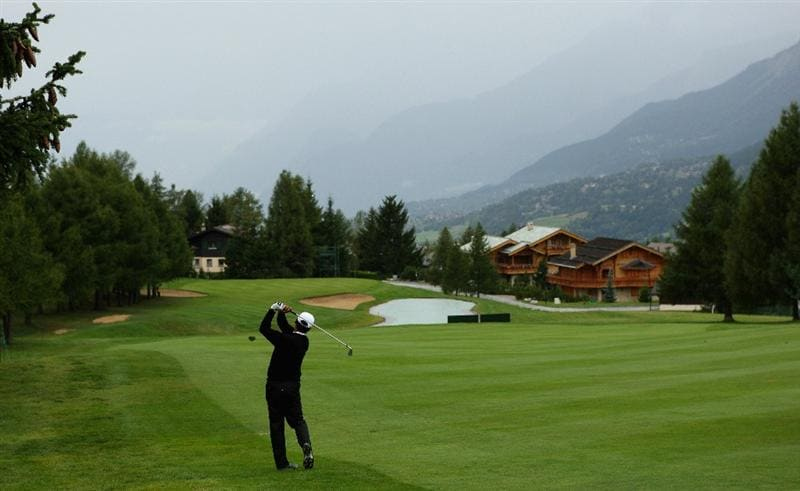 CRANS, SWITZERLAND - SEPTEMBER 04:  Michael Campbell of New Zealand hits his second shot on the 14th hole during the first round of the Omega European Masters at Crans-Sur-Sierre Golf Club on September 4, 2008 in Crans Montana, Switzerland.  (Photo by Andrew Redington/Getty Images)