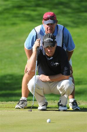 SCOTTSDALE, AZ - OCTOBER 26: Cameron Beckman lines up a birdie putt with his caddy 'Cubby' during the fourth and final round of  the Fry's.Com Open held at Grayhawk Golf Club on October 26, 2008 in Scottsdale, Arizona. (Photo by Marc Feldman/Getty Images)