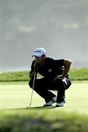 PEBBLE BEACH, CA - FEBRUARY 14:  Dustin Johnson lines up the winning putt on the 18th hole during the final round of the AT&T Pebble Beach National Pro-Am at Pebble Beach Golf Links on February 14, 2010 in Pebble Beach, California.  (Photo by Stephen Dunn/Getty Images)