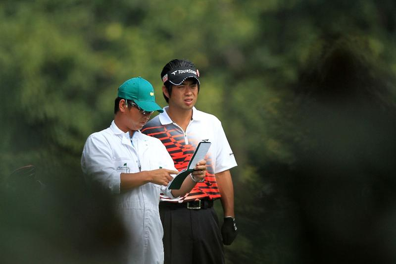 AUGUSTA, GA - APRIL 08:  Yuta Ikeda of Japan looks on alongside his caddie Hisashi Fukuda before hitting his second shot on the fifth hole during the second round of the 2011 Masters Tournament at Augusta National Golf Club on April 8, 2011 in Augusta, Georgia.  (Photo by David Cannon/Getty Images)
