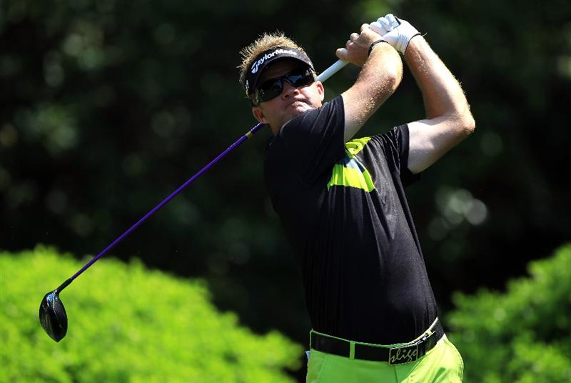 HILTON HEAD ISLAND, SC - APRIL 21:  Brian Gay hits his tee shot on the 12th hole during the first round of The Heritage at Harbour Town Golf Links on April 21, 2011 in Hilton Head Island, South Carolina.  (Photo by Streeter Lecka/Getty Images)