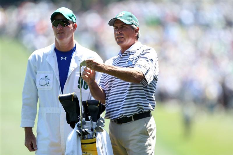 AUGUSTA, GA - APRIL 07:  Fred Couples talks with his caddie Joe LaCava on the first hole during the first round of the 2011 Masters Tournament at Augusta National Golf Club on April 7, 2011 in Augusta, Georgia.  (Photo by Andrew Redington/Getty Images)