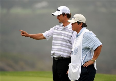 SAN DIEGO - JUNE 14:  Adam Scott of Australia chats with his caddie Tony Navarro during the third round of the 108th U.S. Open at the Torrey Pines Golf Course (South Course) on June 14, 2008 in San Diego, California.  (Photo by Harry How/Getty Images)