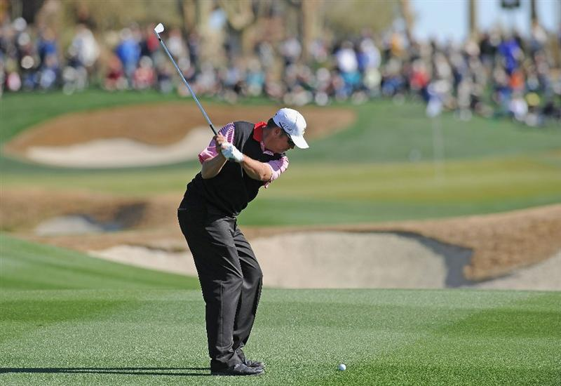 MARANA, AZ - FEBRUARY 23:  Bo Van Pelt plays his approach shot on the 18th hole during the first round of the World Golf Championships-Accenture Match Play Championship held at The Ritz-Carlton Golf Club, Dove Mountain on February 23, 2011 in Marana, Arizona.  (Photo by Stuart Franklin/Getty Images)