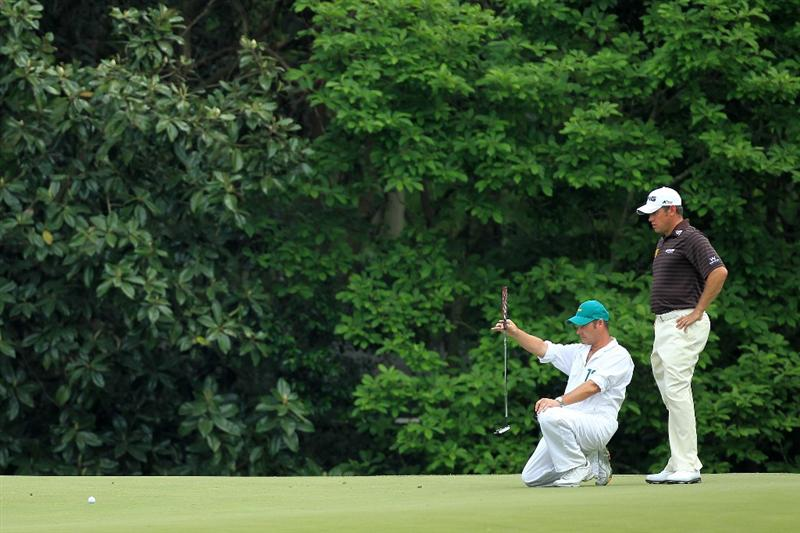 AUGUSTA, GA - APRIL 08:  Lee Westwood of England waits with his caddie Billy Foster on the fifth green during the second round of the 2011 Masters Tournament at Augusta National Golf Club on April 8, 2011 in Augusta, Georgia.  (Photo by David Cannon/Getty Images)