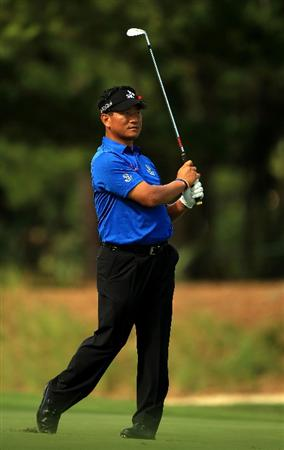 PONTE VEDRA BEACH, FL - MAY 15:  K.J. Choi of South Korea hits an approach shot on the 11th hole during the final round of THE PLAYERS Championship held at THE PLAYERS Stadium course at TPC Sawgrass on May 15, 2011 in Ponte Vedra Beach, Florida.  (Photo by Streeter Lecka/Getty Images)