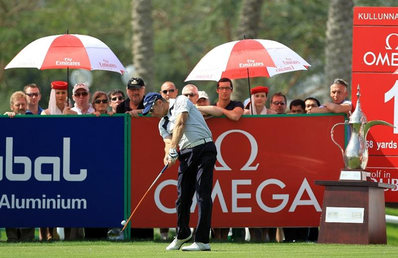 DUBAI, UNITED ARAB EMIRATES - FEBRUARY 13:  James Kingston of South Africa plays his tee shot at the 1st hole during the final round of the 2011 Omega Dubai Desert Classic on the Majilis Course at the Emirates Golf Club on February 13, 2011 in Dubai, United Arab Emirates.  (Photo by David Cannon/Getty Images)