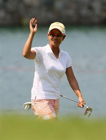 SINGAPORE - FEBRUARY 28:  Ai Miyazato of Japan waves to the crowd on the 18th hole during the final round of the HSBC Women's Champions at Tanah Merah Country Club on February 28, 2010 in Singapore, Singapore.   (Photo by Andy Lyons/Getty Images)