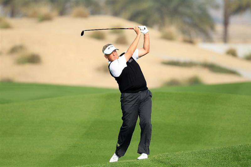 BAHRAIN, BAHRAIN - JANUARY 27:  Colin Montgomerie of Scotland plays his second shot at the 14th hole during the first round of the 2011 Volvo Champions held at the Royal Golf Club on January 27, 2011 in Bahrain, Bahrain.  (Photo by David Cannon/Getty Images)