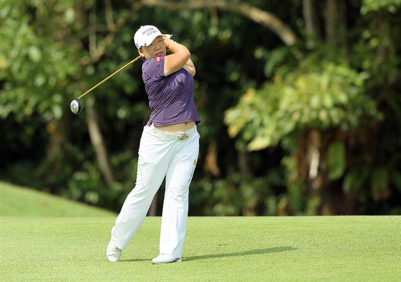 SINGAPORE - FEBRUARY 27:  Jiyai Shin of South Korea hits her second shot on the 4th hole during the third round of the HSBC Women's Champions at Tanah Merah Country Club on February 27, 2010 in Singapore, Singapore.  (Photo by Andy Lyons/Getty Images)
