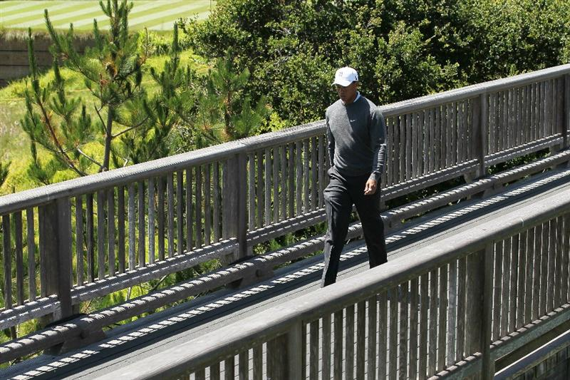 PEBBLE BEACH, CA - JUNE 17:  Tiger Woods walks across the bridge on the third hole during the first round of the 110th U.S. Open at Pebble Beach Golf Links on June 17, 2010 in Pebble Beach, California.  (Photo by Jeff Gross/Getty Images)